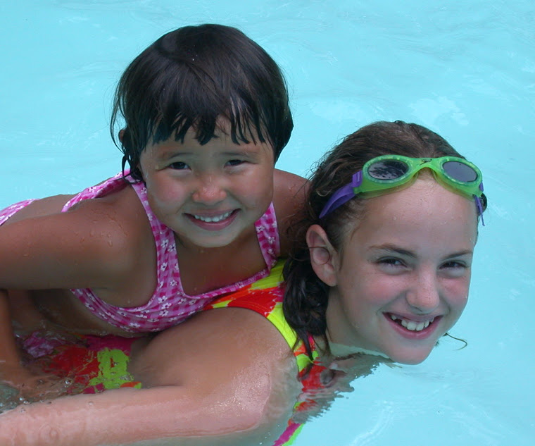 DANELYA AND SAMANTHA IN THE POOL